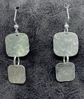 Earrings of hammered sterling silver squares