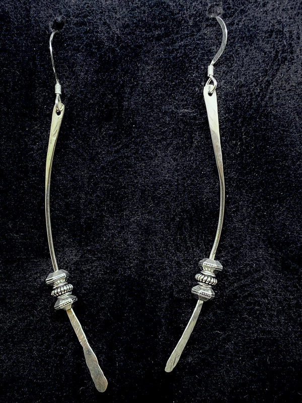 Earrings of hand-tooled sterling silver inspired by Samurai swords