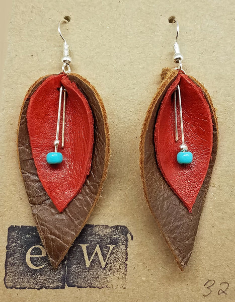 Earrings of brown and red leaf cut leather with turquoise bead drop