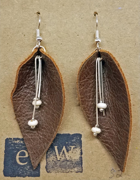 Earrings of brown leather leaf with ivory bead drop