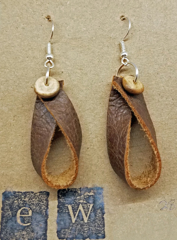 Earrings of looped leather with a wood bead embellishment