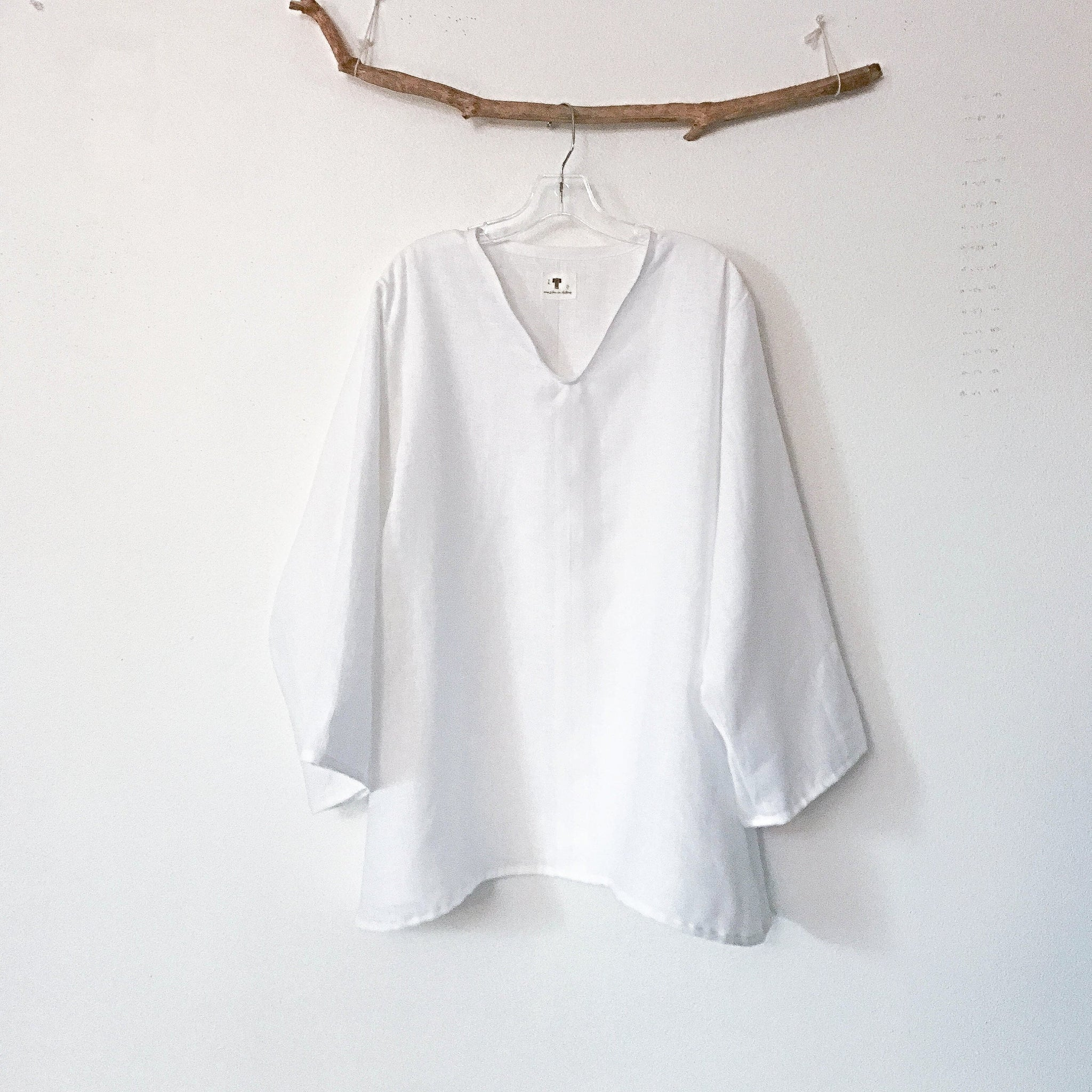 minimalist white linen blouse with V neck