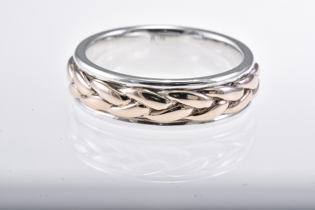 Sterling Silver & 14Kt yellow gold band with braided enter