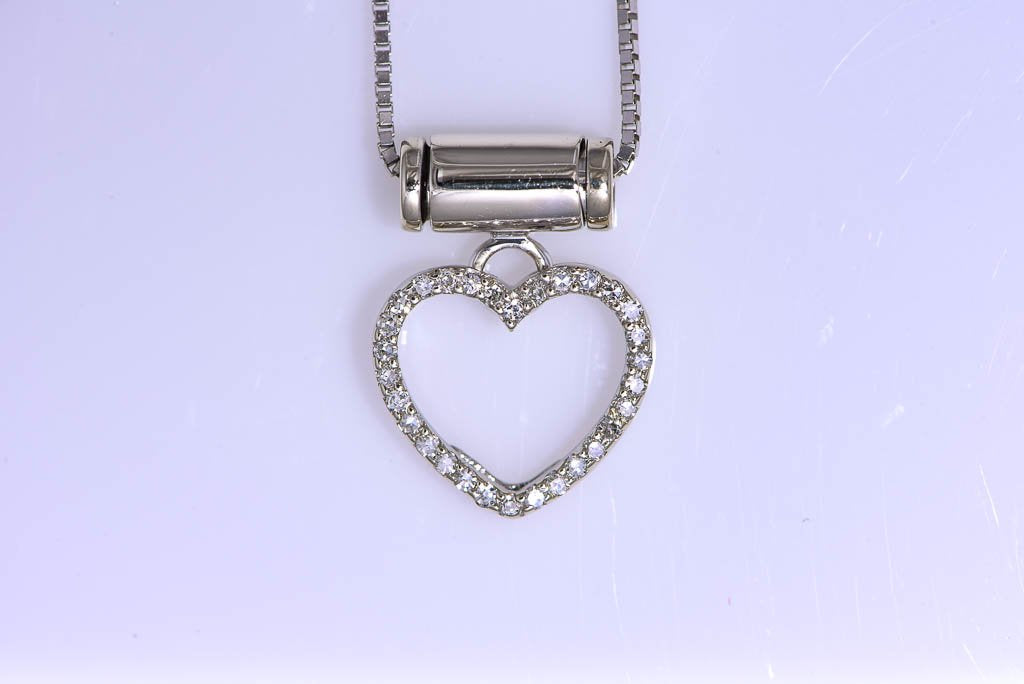 14Kt white gold diamond heart necklace on 16