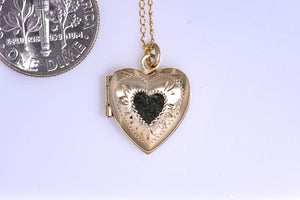"14Kt yellow gold Estate small heart locket on 16"" chain"