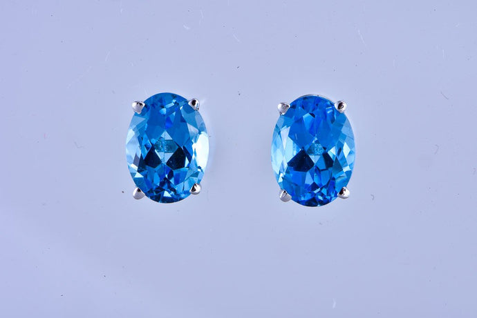 14Kt white gold oval blue topaz stud earrings