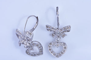 14Kt white gold bow & heart diamond dangle earrings