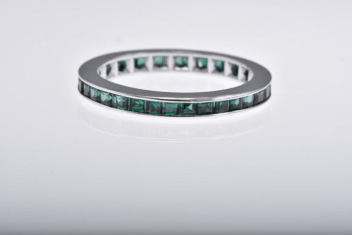 14Kt white gold Eternity Band with Synthetic Green Channel set