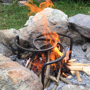 Campfire trivet over an open fire