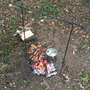 2in1 campfire cooking tripod being used as a hanging bar.