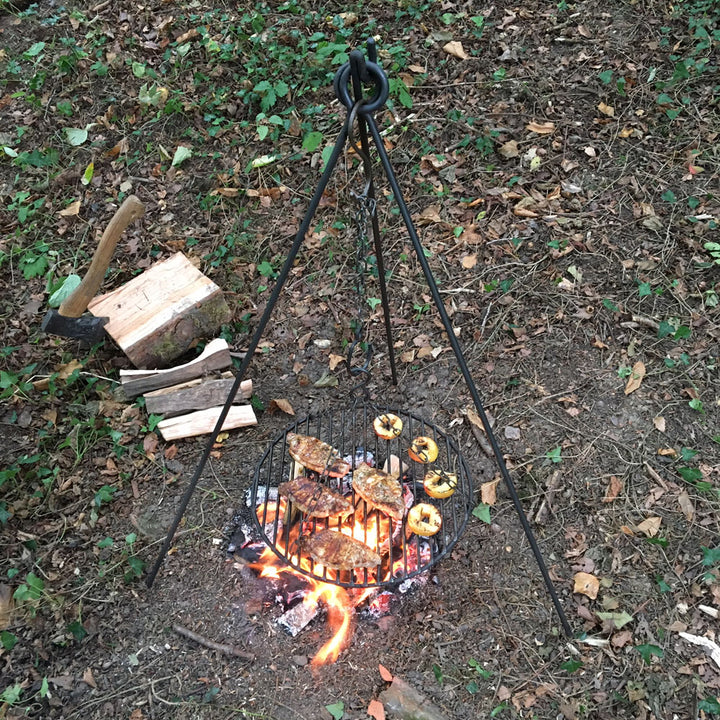 2in1 campfire cooking tripod being used over an open fire.