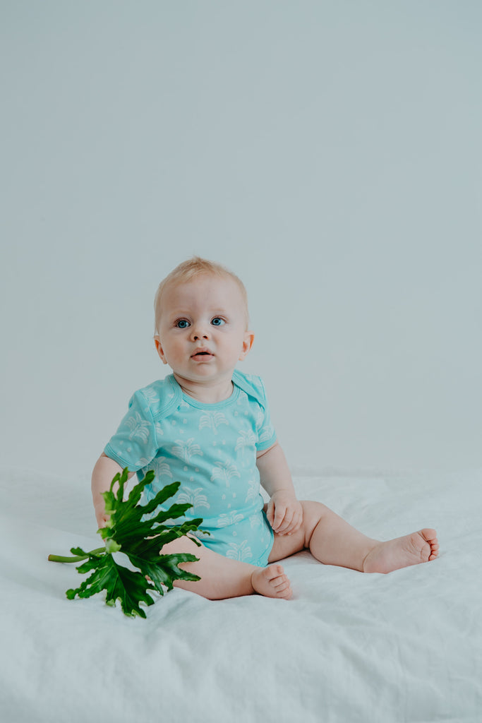GOTS-Certified Organic Cotton Summer Short-Sleeve Sleepsuit  - Palms and Pineapples in Island Water Green