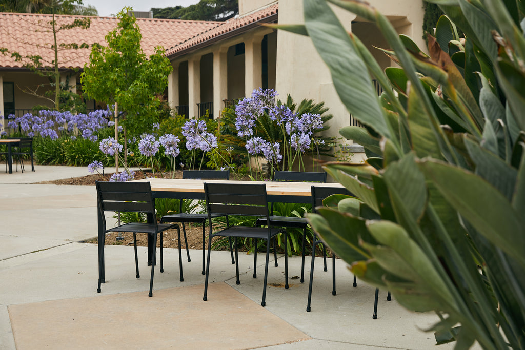 Wooden outdoor dining table and chairs