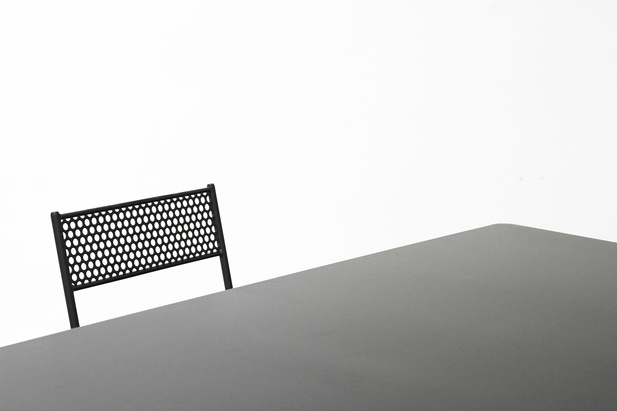 RAD Furniture's Solid Steel-top Dining Table and Perforated Cafe Chair