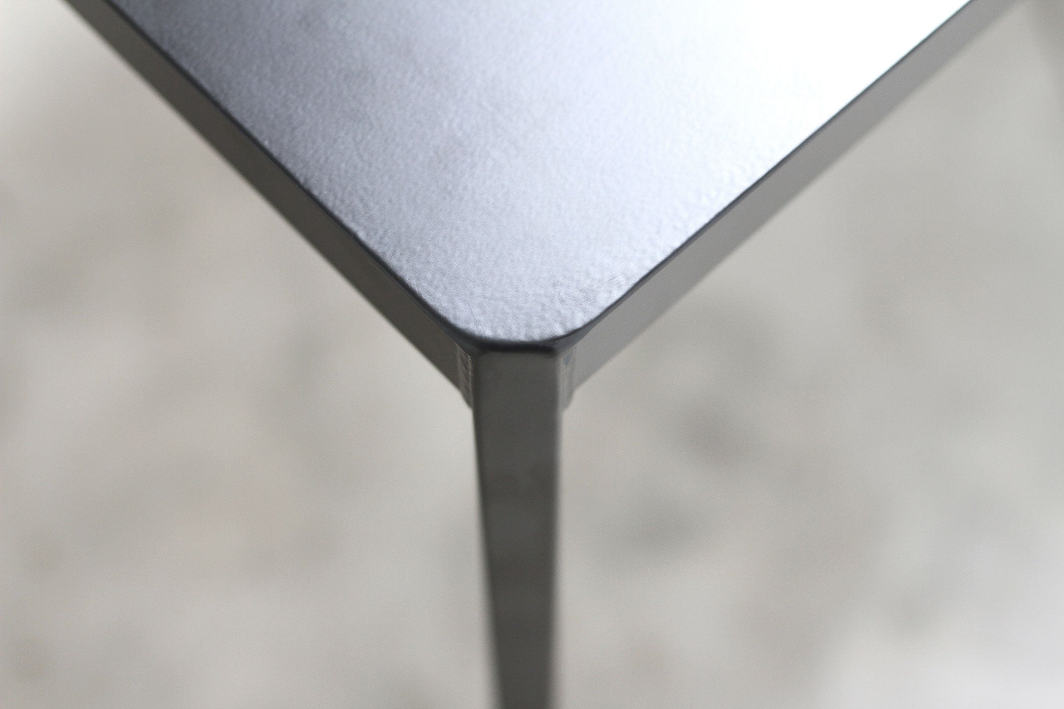 RAD Furniture's Solid Steel-top Dining Table - detail