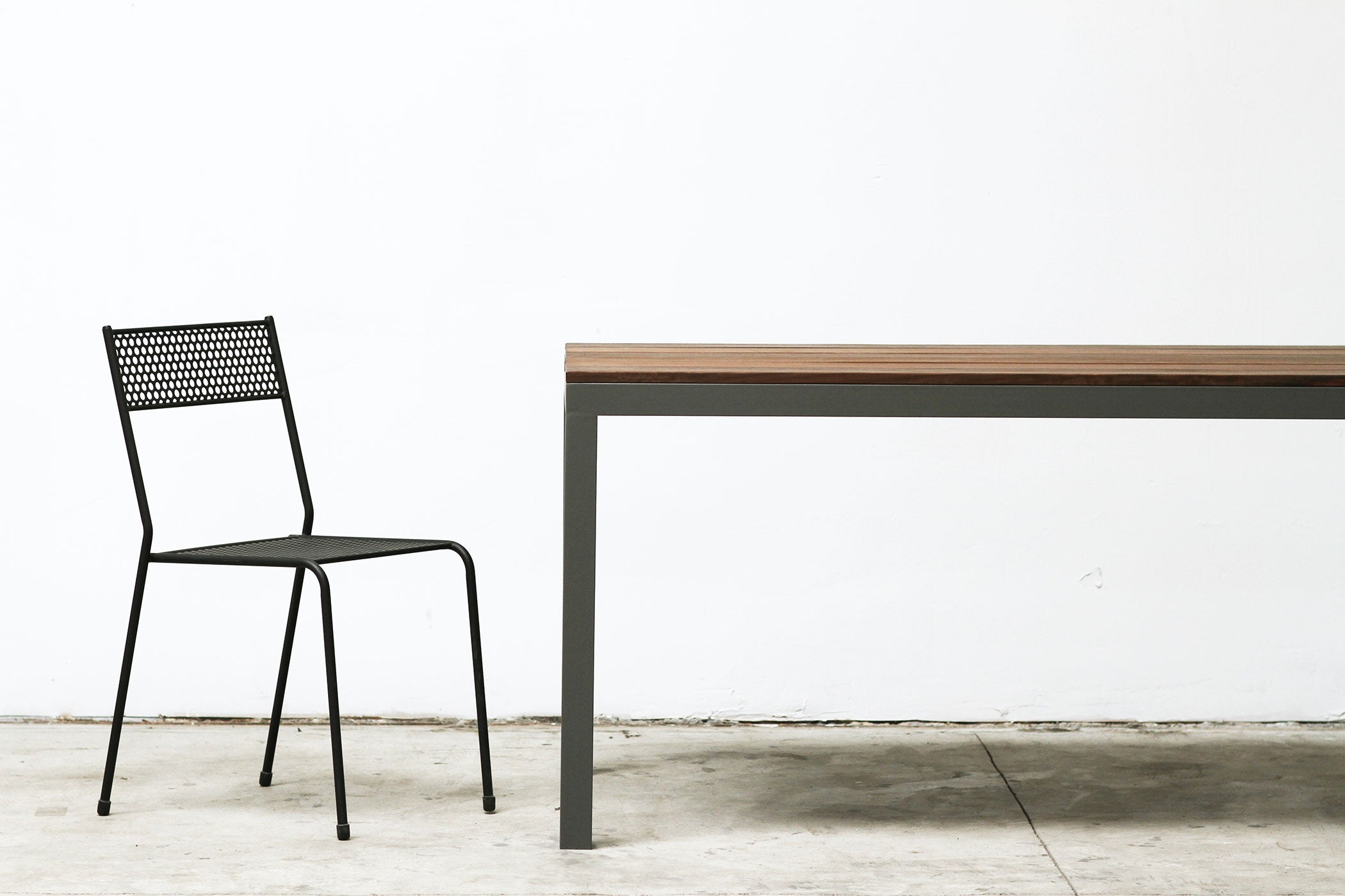 RAD Furniture's Slatted Wood-top Dining Table and Perforated Cafe Chair