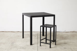RAD Furniture's Perforated Drop Bar Stool with Perforated Bar-Height Dining Table