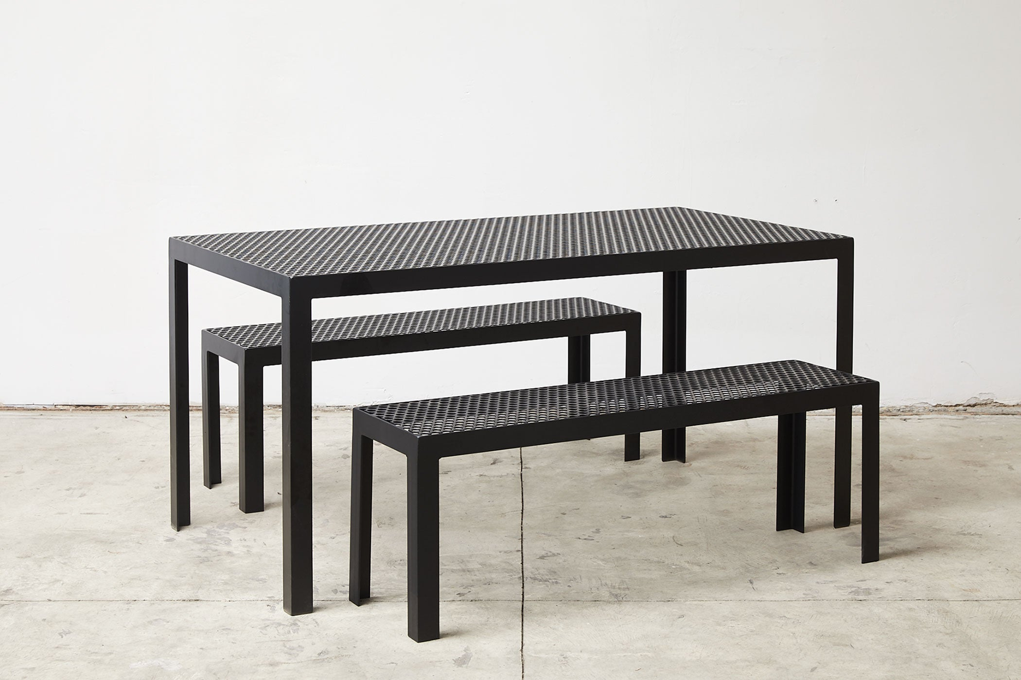 RAD Furniture's Perforated Benches with Perforated Dining Table