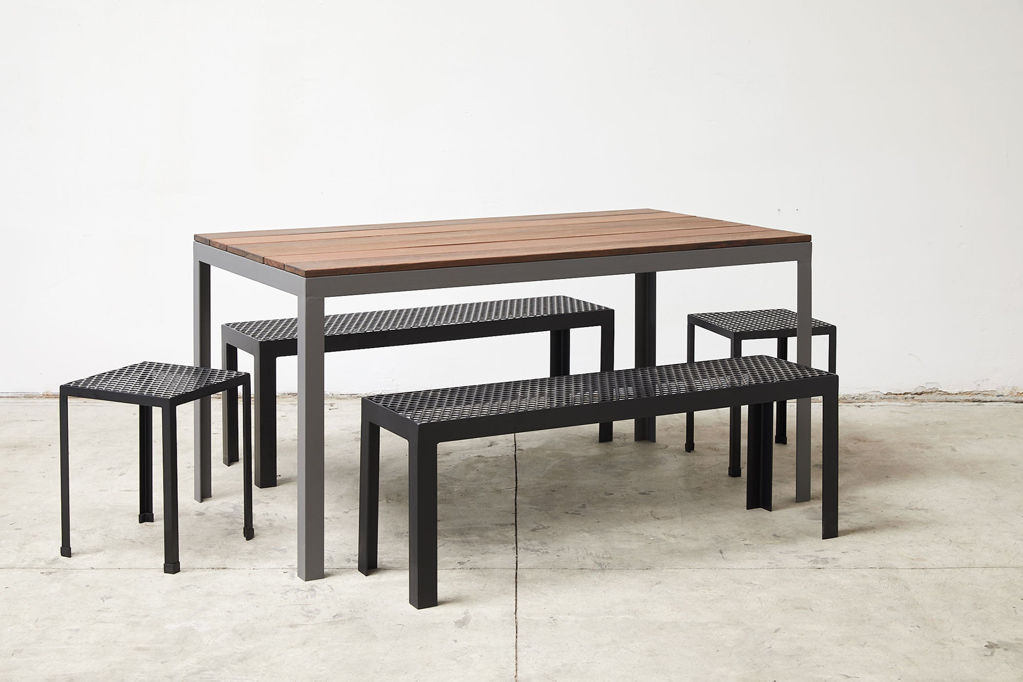 RAD Furniture's Perforated Benches, Perforated Knockaround Stools, and Slatted Wood-top Dining Table