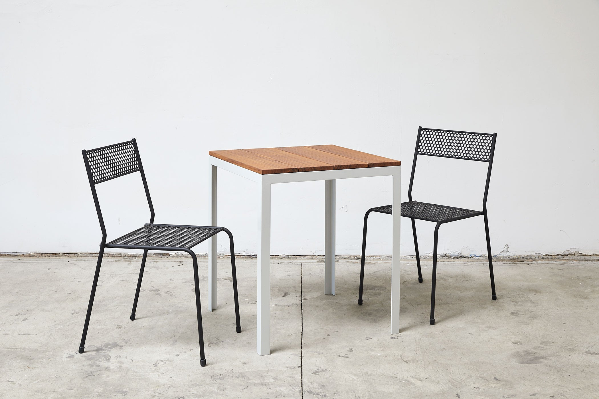RAD Furniture's Perforated Cafe Chair and Solid Wood-top Table