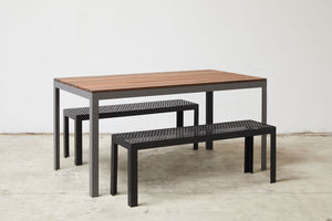 RAD Furniture's Slatted Wood-top Dining Table and Perforated Benches