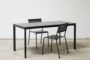 RAD Furniture's Solid Steel-top Dining Table and Slatted Dining Chairs