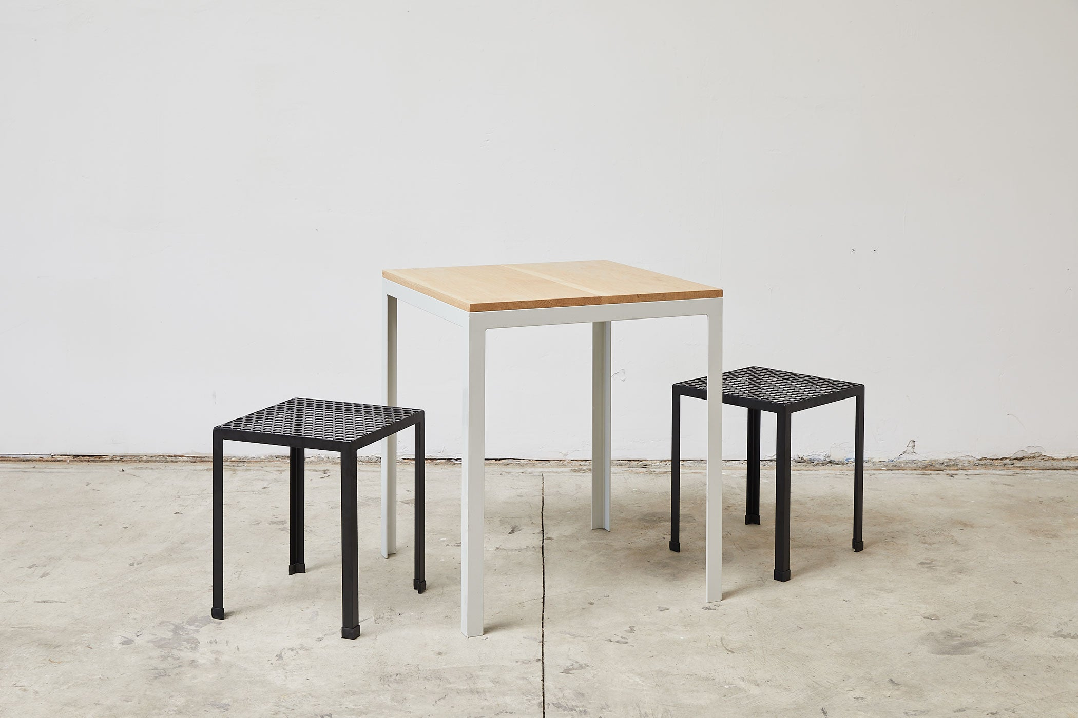 RAD Furniture's Solid Wood-top Cafe Table with Perforated Knockaround Stools