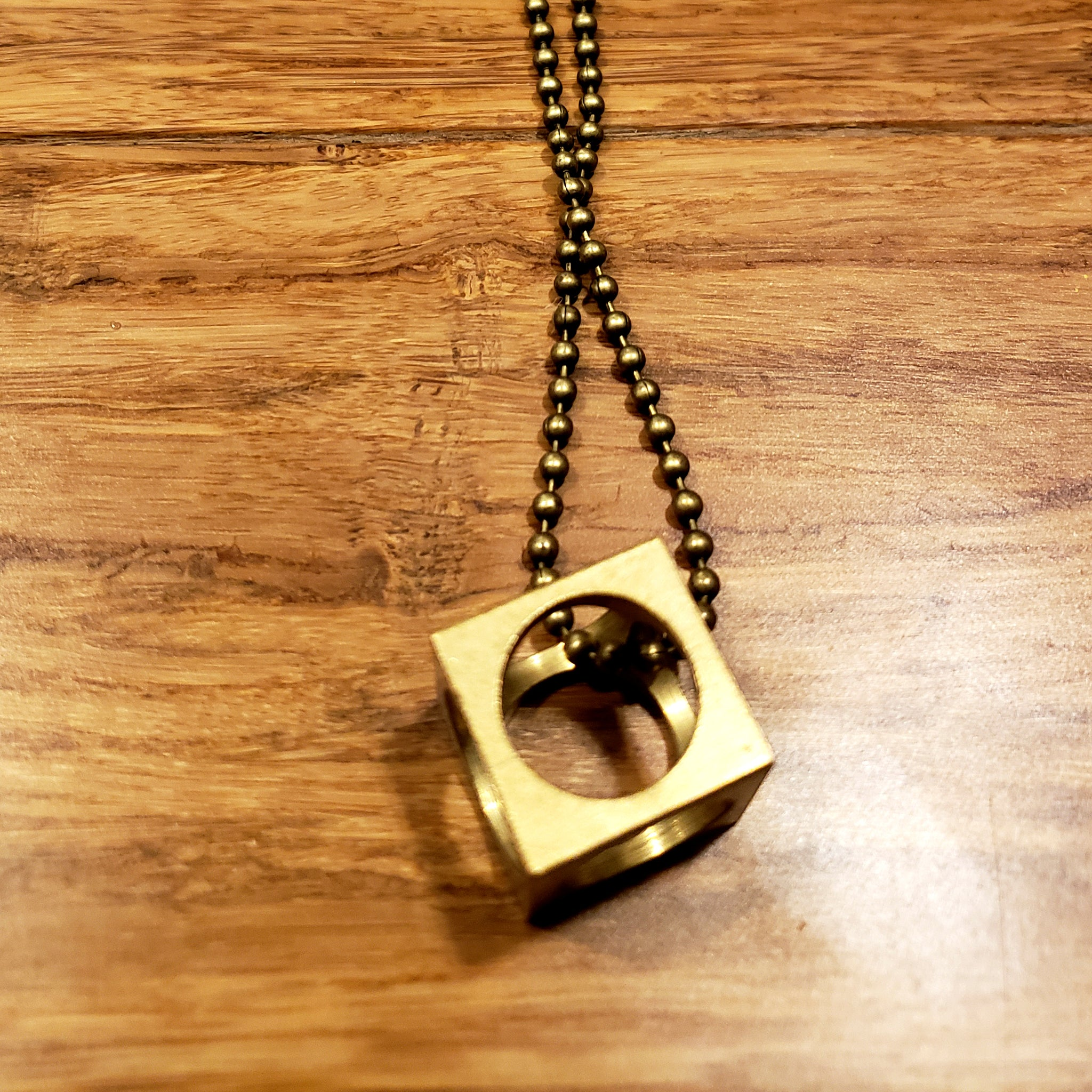 """Don't Box Me In"" Brass Cube Charm Necklace"