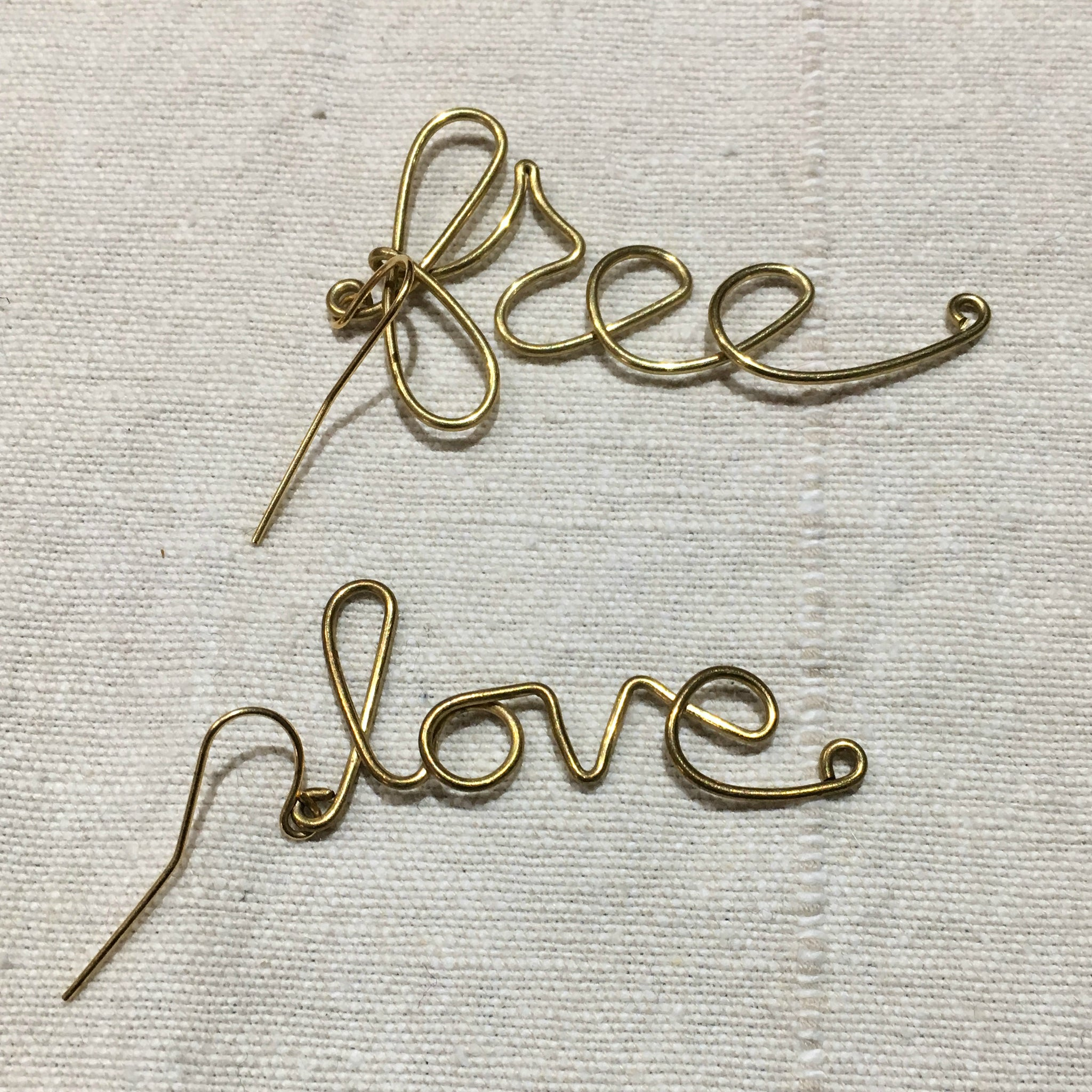 """Say What You Mean to Say"" Wrought Brass Cursive Earrings"