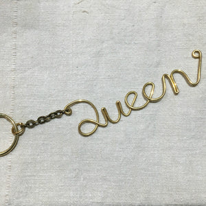 """Tell Me More"" Wrought Brass Cursive Keychain"