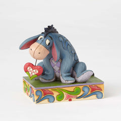 Jim Shore - Winnie the Pooh: Eeyore Love 'Heart on a String' (Disney Traditions Figurine)