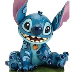 Jim Shore -Stitch Sitting 'Ohana' (Disney Traditions Figurine)