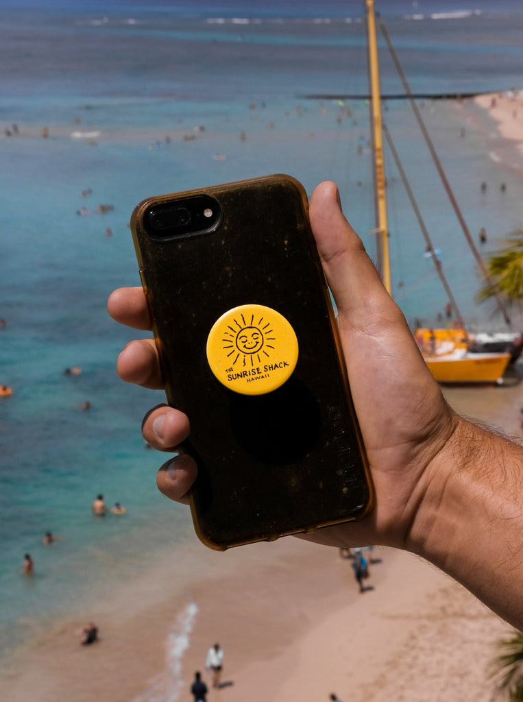 Yellow Popsocket with The Sunrise Shack logo