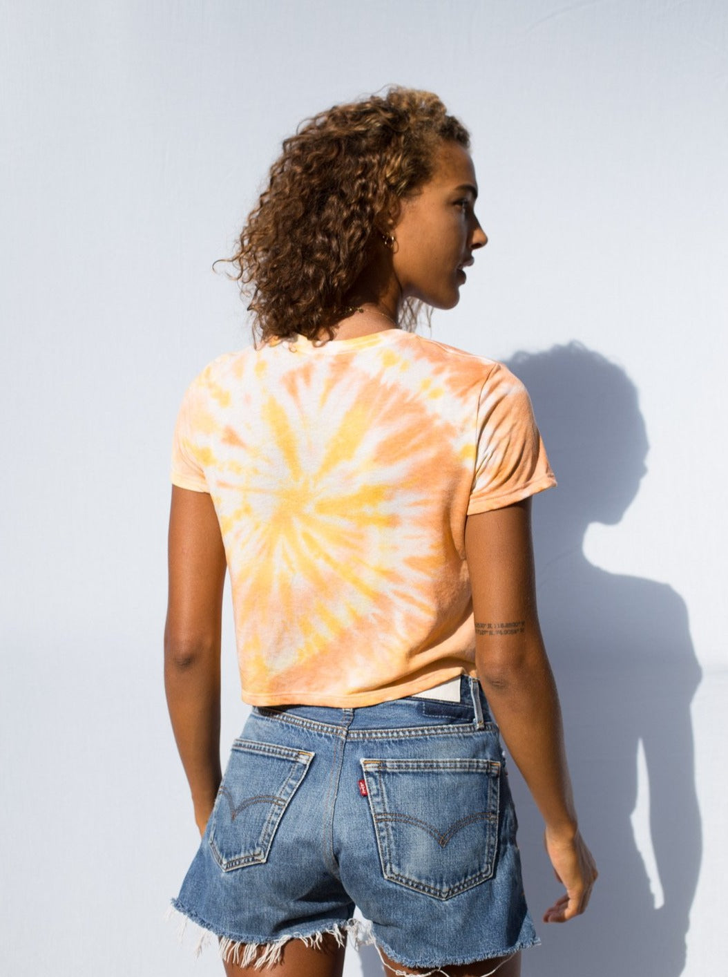 Women's crop yellow tie-dye swirl