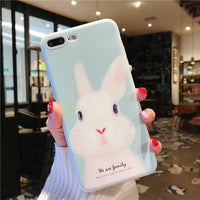 Blue Rabbit and Pink Pig iPhone Cases.