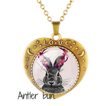 "Load image into Gallery viewer, ""We are family"" Copper and glass rabbit necklace."