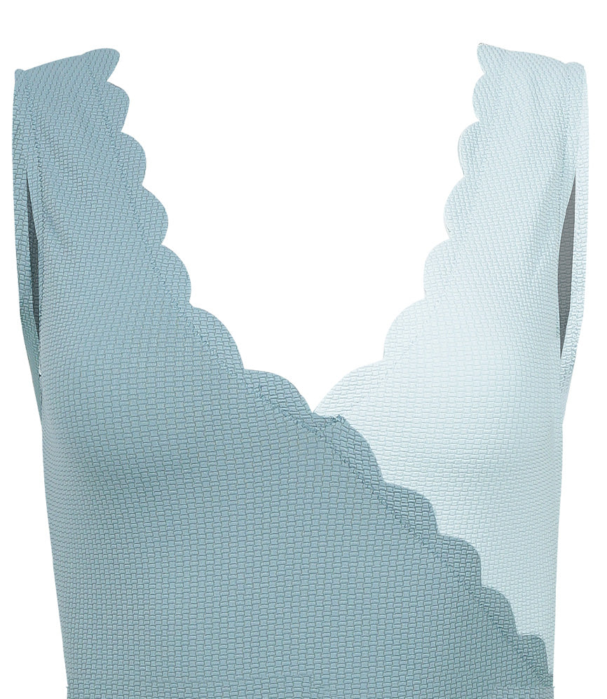 light blue designer swimsuit with scallop edges