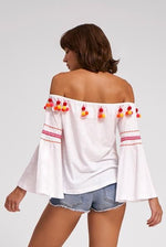woman wearing white long sleeve off the shoulder top