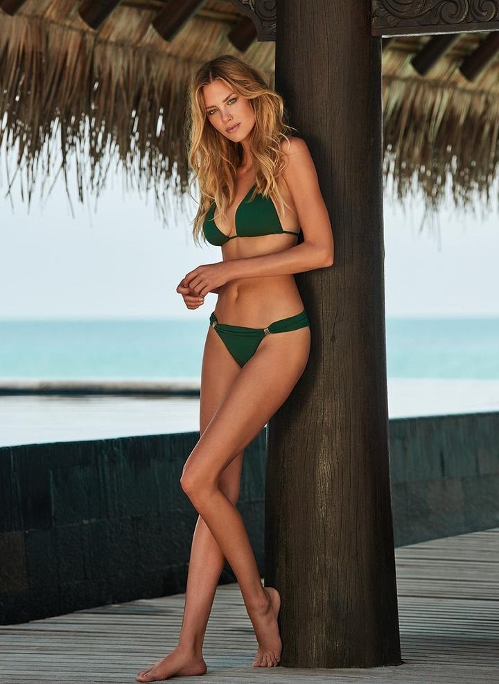 beautiful woman wearing dark green bikini