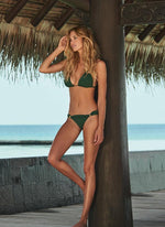 beautiful woman wearing sexy dark green bikini