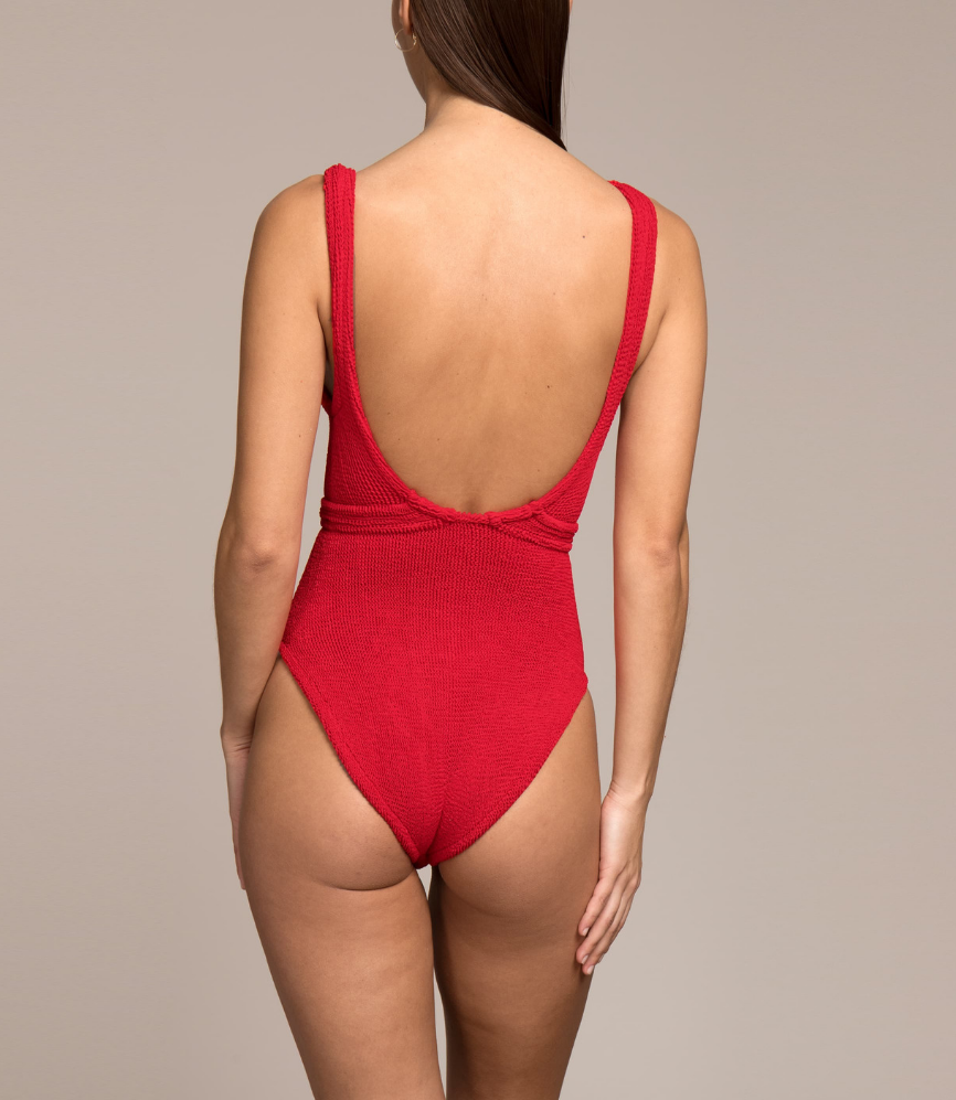 ec728487ae72c fair skin woman wearing a retro red one piece swimsuit with low back