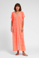 woman wearing a coral maxi dress | coral pink maxi dress | long coral pink dress""