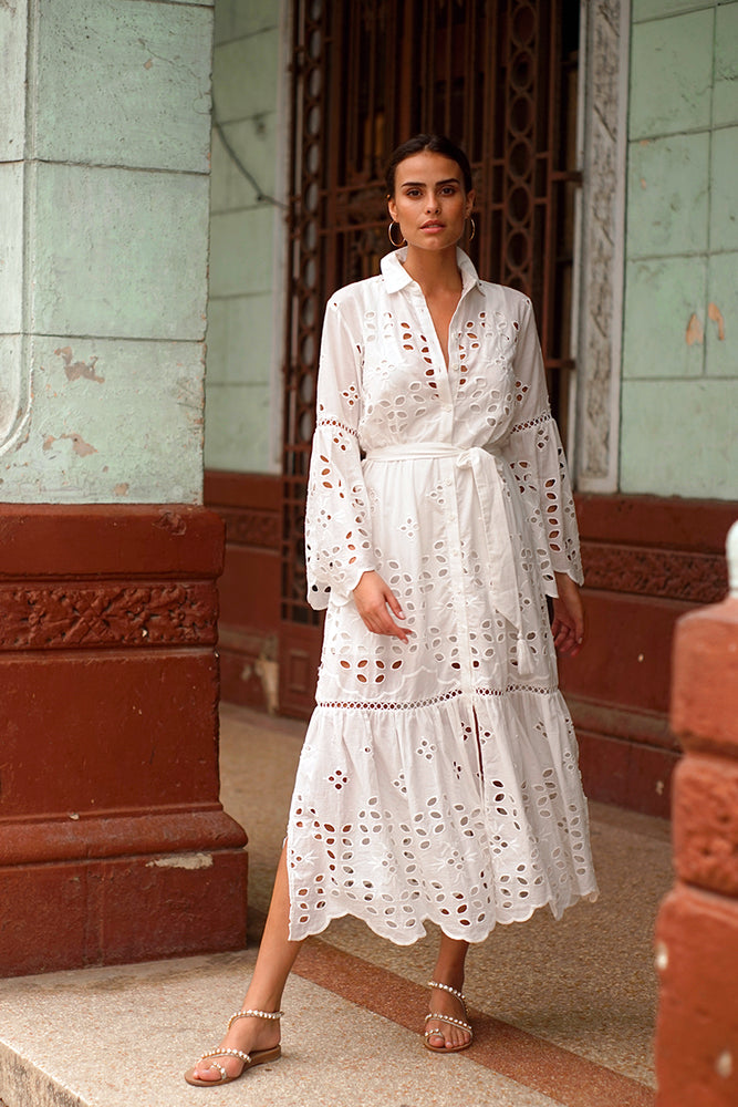 beautiful woman wearing boho beach chic dress in white