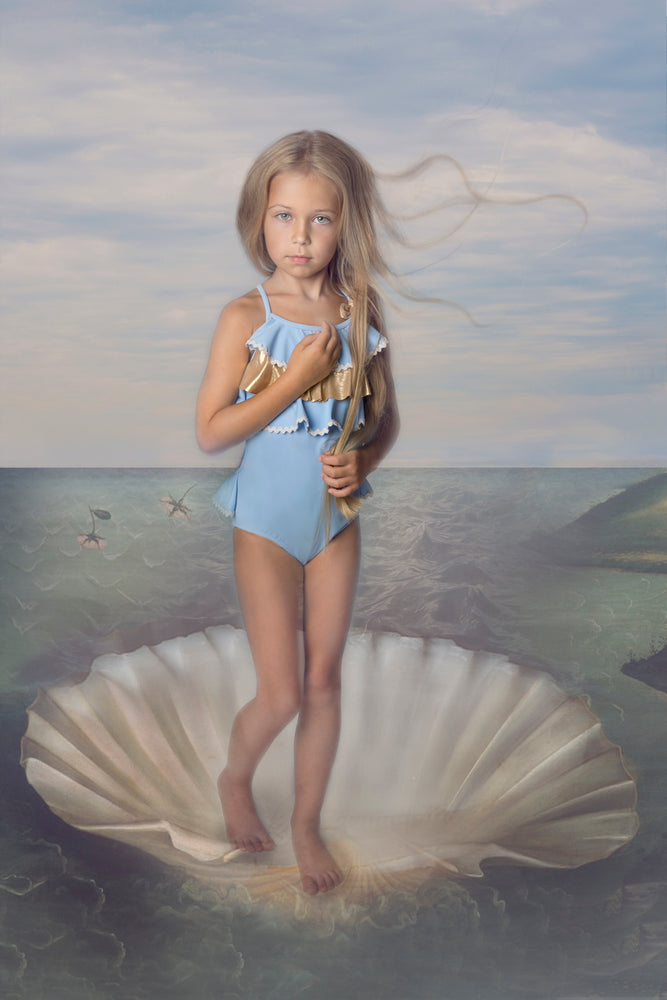 tween girl wearing blue designer swimsuit with ruffles