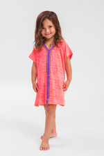 Young Girl Wearing A Little Girls Beach Cover Up in Hot Pink