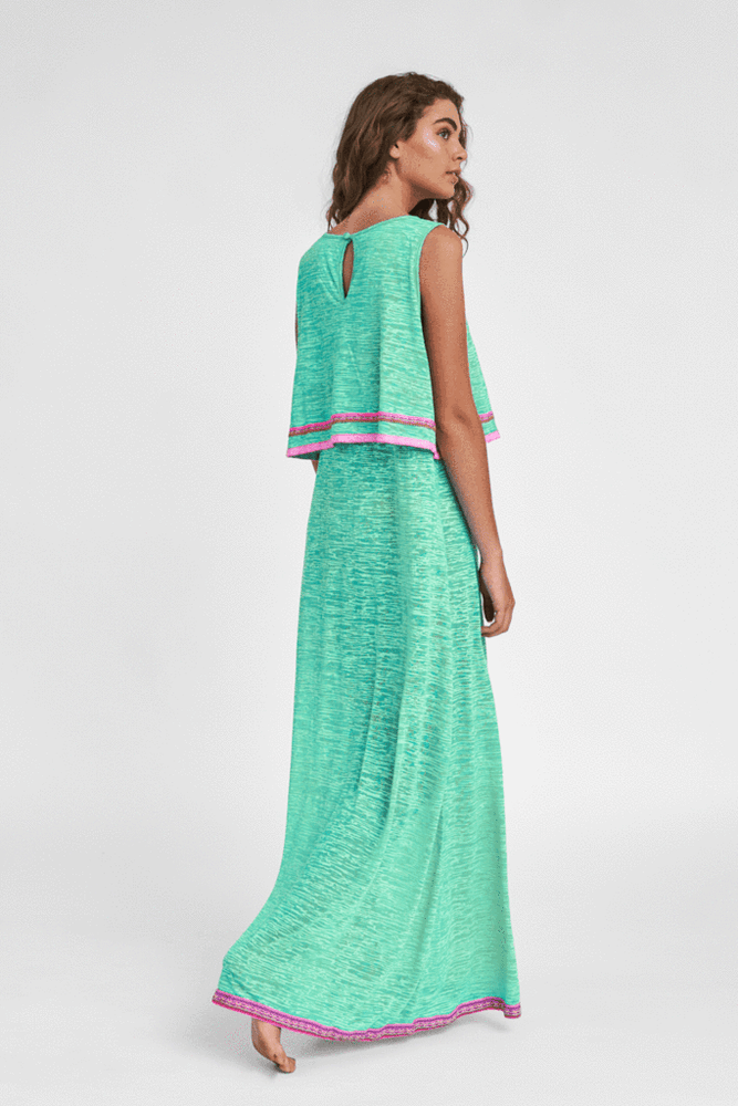 woman wearing a chic maxi dress in teal