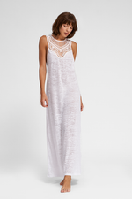 tan woman wearing a White Crochet Maxi Dress