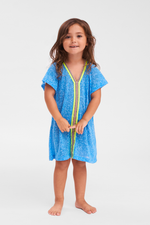 adorable little girl wearing a toddler girls beach cover up in blue