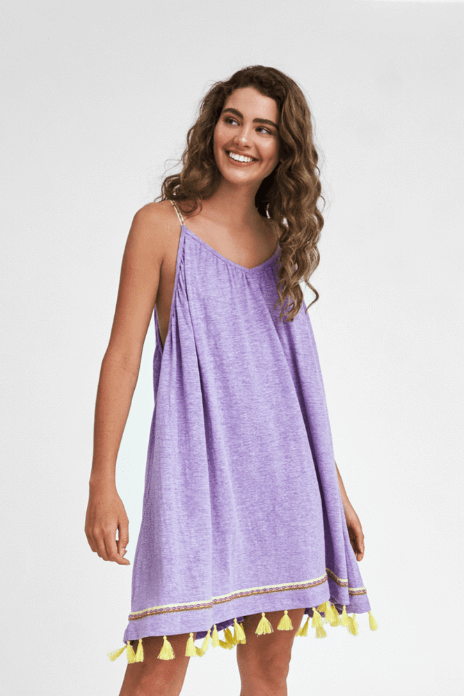 woman wearing a Purple Beach Cover Up with Tassels