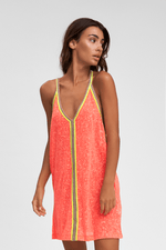 tan woman wearing Mini Sundress in Watermelon Pink